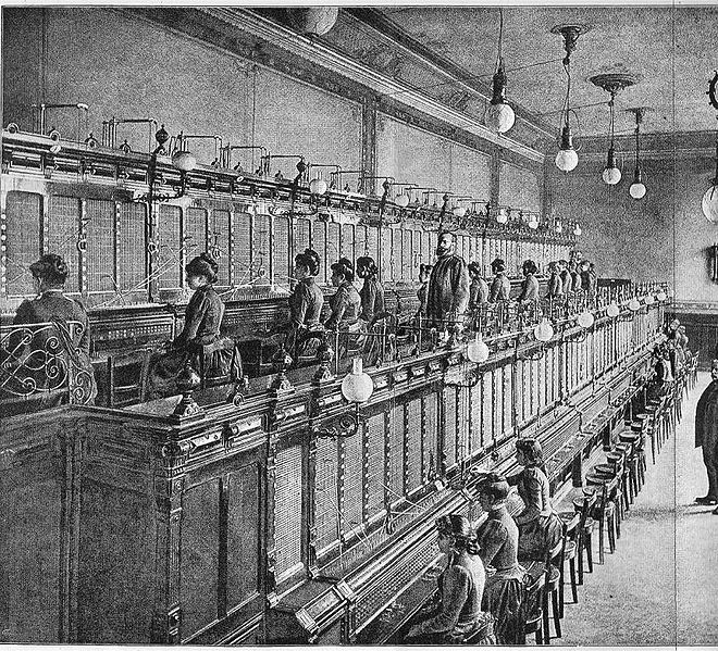 "an historic telephone exchange with two rows of service desks 1893 from the book ""De Electriciteit"" by P. van Capelle from 1893 Kreuger scanned this picture in october 2007 antique book"