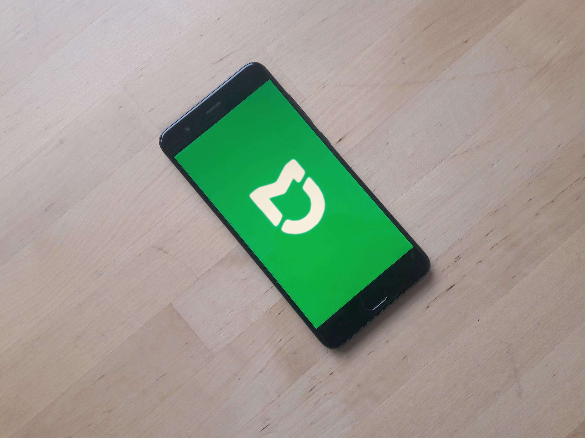 Smartphone Xiaomi avec fond Logo Mijia